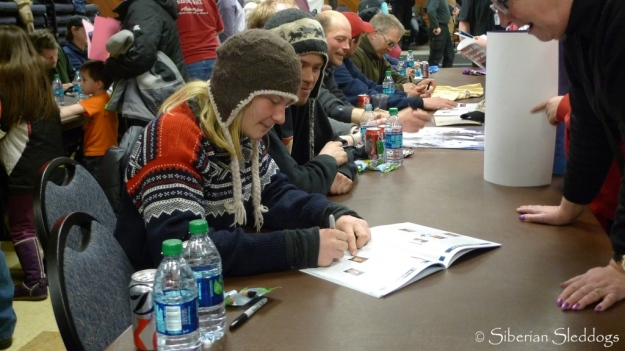 Yvonne, Joar & all the other mushers sign autographs in Nome