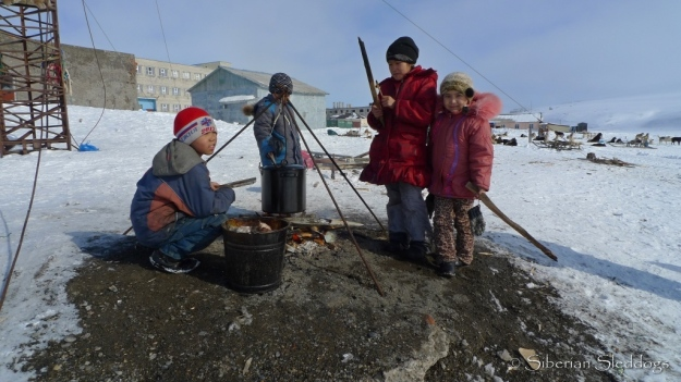 Local kids in Uelen made sure to keep bonfires going and kept an eye on the boiling walrus soup