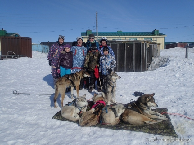 Our team posing with locals in Inchoun