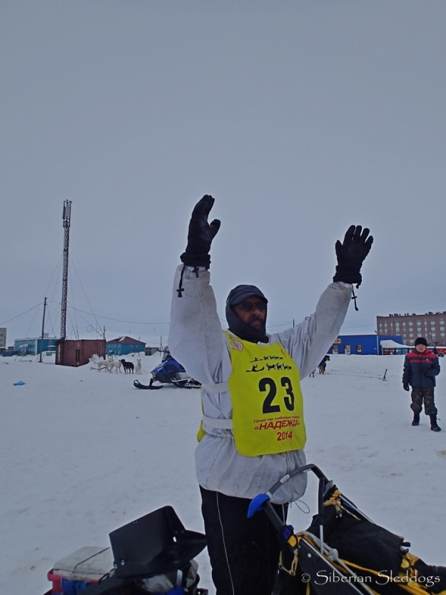 Chuck Schaeffer rising his arms at the finish line in Lavrentiya